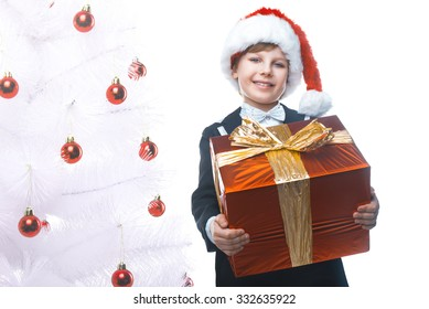beautiful little boy with a big christmas gift in a santa claus hat christmas gifts - Big Christmas Gifts