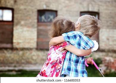 beautiful little boy and girl hug