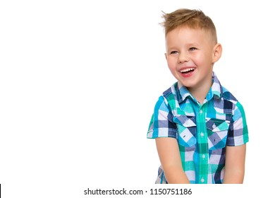 A beautiful little boy laughs fun. The concept of a happy childhood, well-being and family values. Isolated on white background.