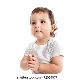 beautiful little boy praying isolated on white