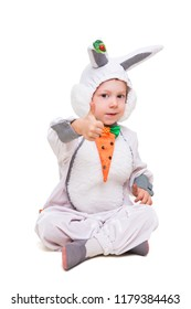 Beautiful little boy wearing like rabbit showing his thumb. Isolated on white