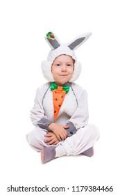 Beautiful little boy wearing like rabbit. Isolated on white