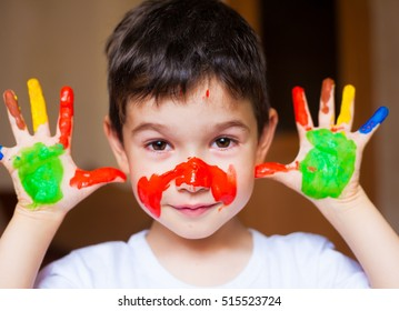 Beautiful little brunet hair boy, has happy fun smiling face, brown eyes, white t-shirt. Painted in skin hands. Child portrait. Creative concept. Water colors.  Close up
