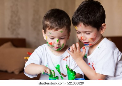 Beautiful little brunet hair boys, has happy fun smiling face, brown eyes, white t-shirt . Painted in skin hands. Child portrait. Creative concept. Water colors.  Close up.