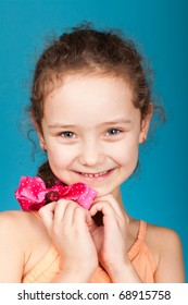 beautiful little caucasian girl isolated on blue background