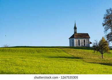 Beautiful little church shinning in a sunny summer day