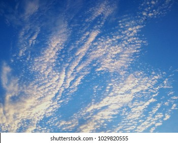 Beautiful little clouds on blue in the evening
