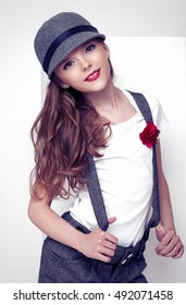 Beautiful little cute fashion model grey clothing on white background