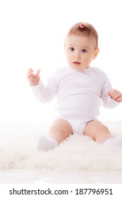 beautiful little girl. age of 7 months. isolated on white background