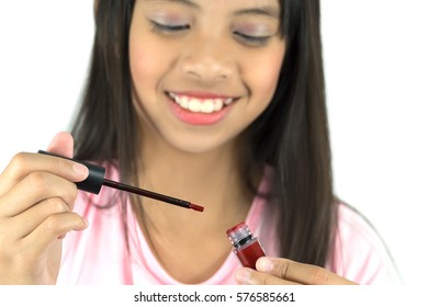 Beautiful Little Girl Applying Red Color Liquid Lipstick on White Background