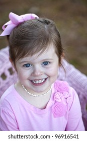 Beautiful little girl with big blue eyes outdoors