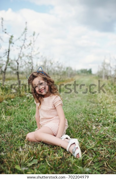 beautiful little girl in blooming garden