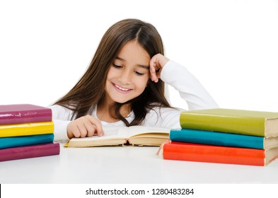 Beautiful little girl with the books. Isolated on a white background