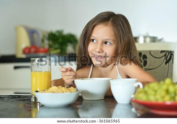 Beautiful little girl with breakfast