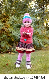 beautiful little girl with brown chestnut in autmun park
