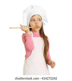 Beautiful little girl in chef uniform with wooden spoon isolated on white