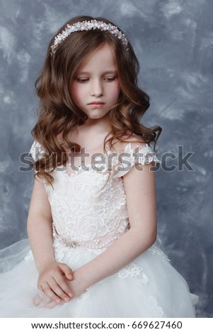 1b937eab6f1b7 Beautiful little girl with curls and white Quinceanera dresses with a train