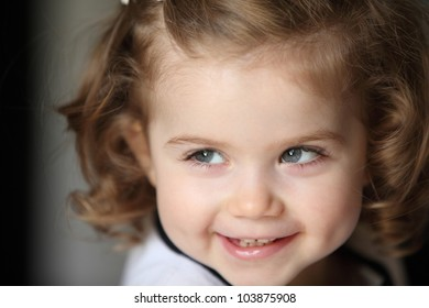 beautiful little girl with curly hair