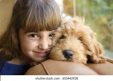 Beautiful Little Girl with Cute Puppy