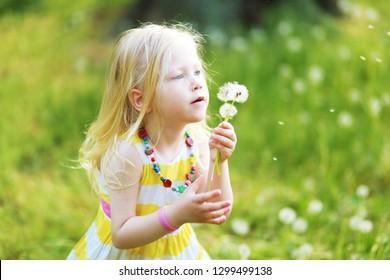 beautiful little girl with dandelion