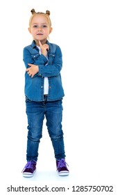 Beautiful little girl in a denim suit. The concept of style and fashion. Isolated on white background.