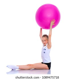 Beautiful little girl doing exercises on a big ball for fitness. The concept of sport and a healthy lifestyle. Isolated on white background.