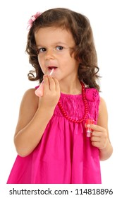 beautiful little girl doing makeup isolated on white