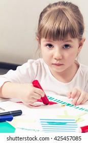 beautiful little girl draws felt pen