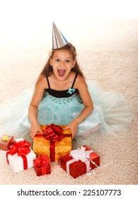 beautiful little girl in a dress with gifts