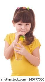 Beautiful little girl drinking orange juice on white background