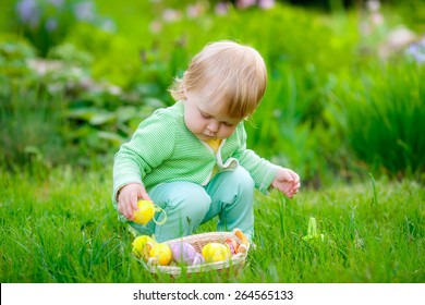 beautiful little girl with easter eggs in nature