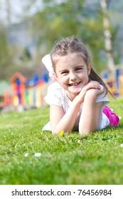 Beautiful little girl enjoying in park