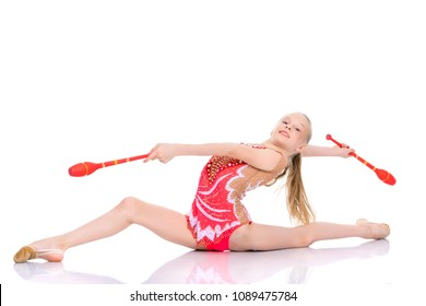 Beautiful little girl gymnast performs exercises with a mace. The concept of children's sports, fitness. Isolated on white background.