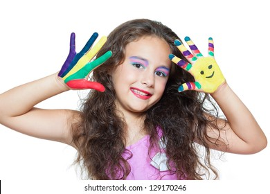 beautiful little girl with hands in the paint isolated on white