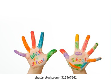 Beautiful little girl with hands in the paint