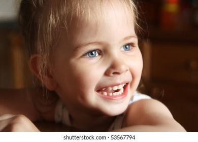 Beautiful little girl happily smiling closeup