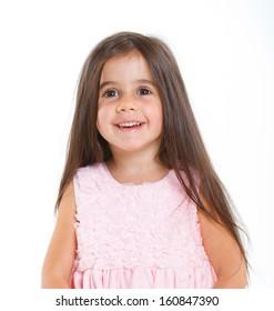 Beautiful little girl happy smiling on studio. Isolated white background
