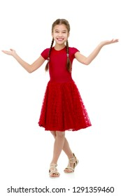 Beautiful little girl is having fun dancing in the studio on a white background. The concept of a school of dance, happy people. Isolated.