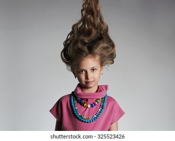 beautiful little girl with healthy hair.pretty little lady in dress and accessories