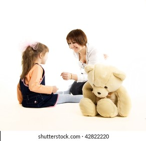 Beautiful little girl and her mother: playing together