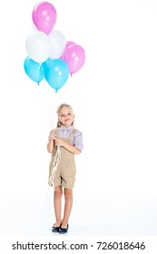 beautiful little girl holding balloons and smiling at camera isolated on white