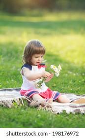 beautiful little girl holding flowers