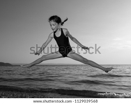 c6eb1d3f Beautiful Little Girl Jumping Seaside Stock Photo (Edit Now ...