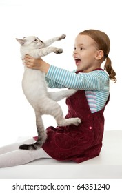 Beautiful little girl with a kitten. On the eastern calendar 2011 - the year the cat.