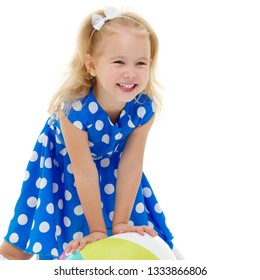 Beautiful little girl laughing. The concept of a happy childhood, emotions. Isolated on white background.