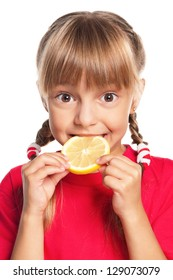 Beautiful little girl with a lemon isolated on white background