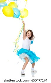 Beautiful little girl in a light blue long skirt, with a bunch of multicolored balloons.Isolated on white background.