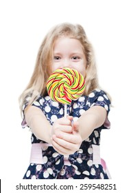 Beautiful little girl with lollipop isolated. Focus on candy