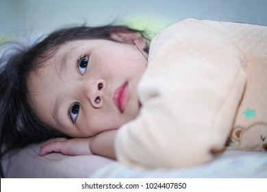 Beautiful little girl is looking.