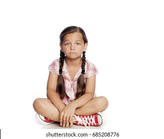 Beautiful little girl looking sad isolated on white background